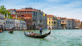 Gondolas are sailing along the Grand Canal in Venice Royalty Free Stock Photo