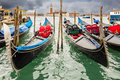 Gondolas several and giorgio maggiore island in venice Royalty Free Stock Photography