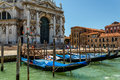 Gondolas and tourists at canal in Venice Royalty Free Stock Image