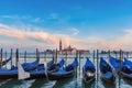 Gondolas at twilight in Venice lagoon, Italia Royalty Free Stock Photo