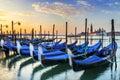 Gondolas in venezia moored by saint mark square with san giorgio di maggiore church the background venice italy europe Stock Photo