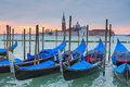 Gondolas of venice in front saint marks square in Stock Photography