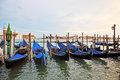 Gondolas in venice row of the venitian lagoon Royalty Free Stock Photography