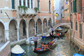 Gondolas venice with tourists on picturesque canal in colorful houses in background Royalty Free Stock Photos
