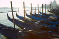 Gondolas waiting for people pier in a autumn day on the background basilica santa maria della salute Royalty Free Stock Photography