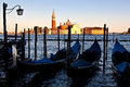 Gondole san giorgio maggiore sunset venice italy streetlighy gondola or in the canal grande in front of the benedictine church Stock Photography