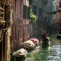 Gondolier floating in a canal in venice italy europe Royalty Free Stock Photos