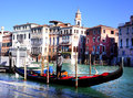 Gondolier on the grand canal a waits for passengers shoreline in venice italy photo taken o a february Stock Images