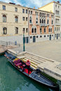 Gondolier man resting in his gondola in between work venice italy Royalty Free Stock Images