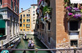 Gondolier rides gondola on the canals of venice june june is one symbols and major mode Stock Photography