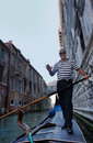Gondolier rides gondola on the canals of venice june june is one symbols and major mode Royalty Free Stock Image