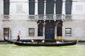 Gondolier rowing and busy with telephone call on the grand canal in venice Royalty Free Stock Photography