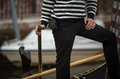 Gondolier striped shirt and black pants of a Royalty Free Stock Image