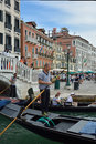 Gondolier with tourists in Venice - Italy. Royalty Free Stock Photo