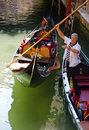 Gondolier venetian navigates the narrow canals Royalty Free Stock Photos