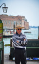 Gondolier venice april on embankment of grand canal on april th in venice italy Royalty Free Stock Photo