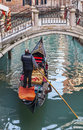 Gondolier venice italy february image of a in a gondola with tourists passing under a bridge on a small venetian canal during the Stock Image