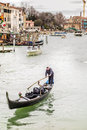 Gondolier venice italy march the grand canal on march in venice italy gondolas are traditional venetian rowing boats well suited Royalty Free Stock Photo