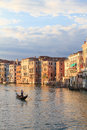 A gondoliere on canal grande seen from rialto bridge in venice at dusk Stock Photography