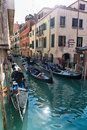 Gondoliere in venice italy october standing on their gondolas within a small canal on october Stock Photo