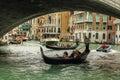 Gondoliere at work under rialto bridge paddling in venice Stock Image