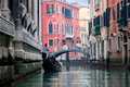 Gondoliero sailing in Venice channel Royalty Free Stock Photography