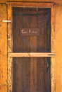 Gone fishing sign on wooden cabin door Royalty Free Stock Photography