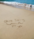 Gone fishing written in the sand at the beach holiday concept Royalty Free Stock Images