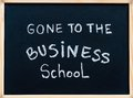 Gone to the business school message written with white chalk on wooden frame blackboard learning concept Royalty Free Stock Images