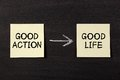 Good action results good life concept on black chalkboard Stock Photos