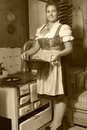 Good appetite young peasant woman on the mountain when cooking food in black white Stock Photo
