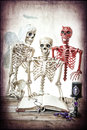 The good the bad and the dead a skeleton man being coaxed by his side classic versus evil Royalty Free Stock Images