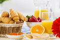 Good beginning of day breakfast with assortment pastries coffees and fresh strawberries Royalty Free Stock Images