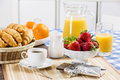Good beginning of day breakfast with assortment pastries coffees and fresh strawberries Royalty Free Stock Photos