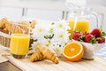 Good beginning of day breakfast with assortment pastries coffees and fresh strawberries Royalty Free Stock Image