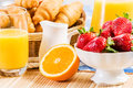 Good beginning of day breakfast with assortment pastries coffees and fresh strawberries Stock Images