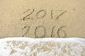 Good bye 2016 hello 2017. inscription written in the beach sand.