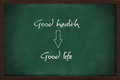 Good health leads to good life written on chalkboard Royalty Free Stock Photo