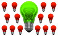 Good idea among lots of bad ideas one green and many red light bulbs with weird reflections Stock Image