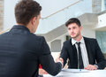 Good job successful and motivated businessmen is shaking hand of his business partner approving the deal Stock Image