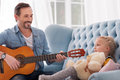Good looking caring father singing for his daughter Royalty Free Stock Photo