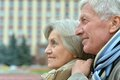 Good looking elderly couple standing at wall Stock Photos
