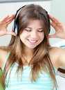 Good-looking girl listening to music Stock Images
