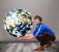 Good looking man holding d planet earth young Stock Image