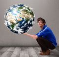Good looking man holding d planet earth young Royalty Free Stock Images