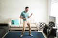 Attractive man dancing in the living room Royalty Free Stock Photo