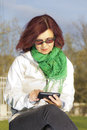 Good looking mid age woman with tablet phone Royalty Free Stock Images