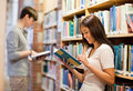 Good looking students reading books Royalty Free Stock Photos