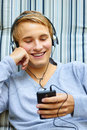 Good looking young male checking out song list on phone Stock Photo