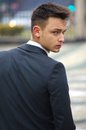 Good looking young man in suit, back view Stock Image